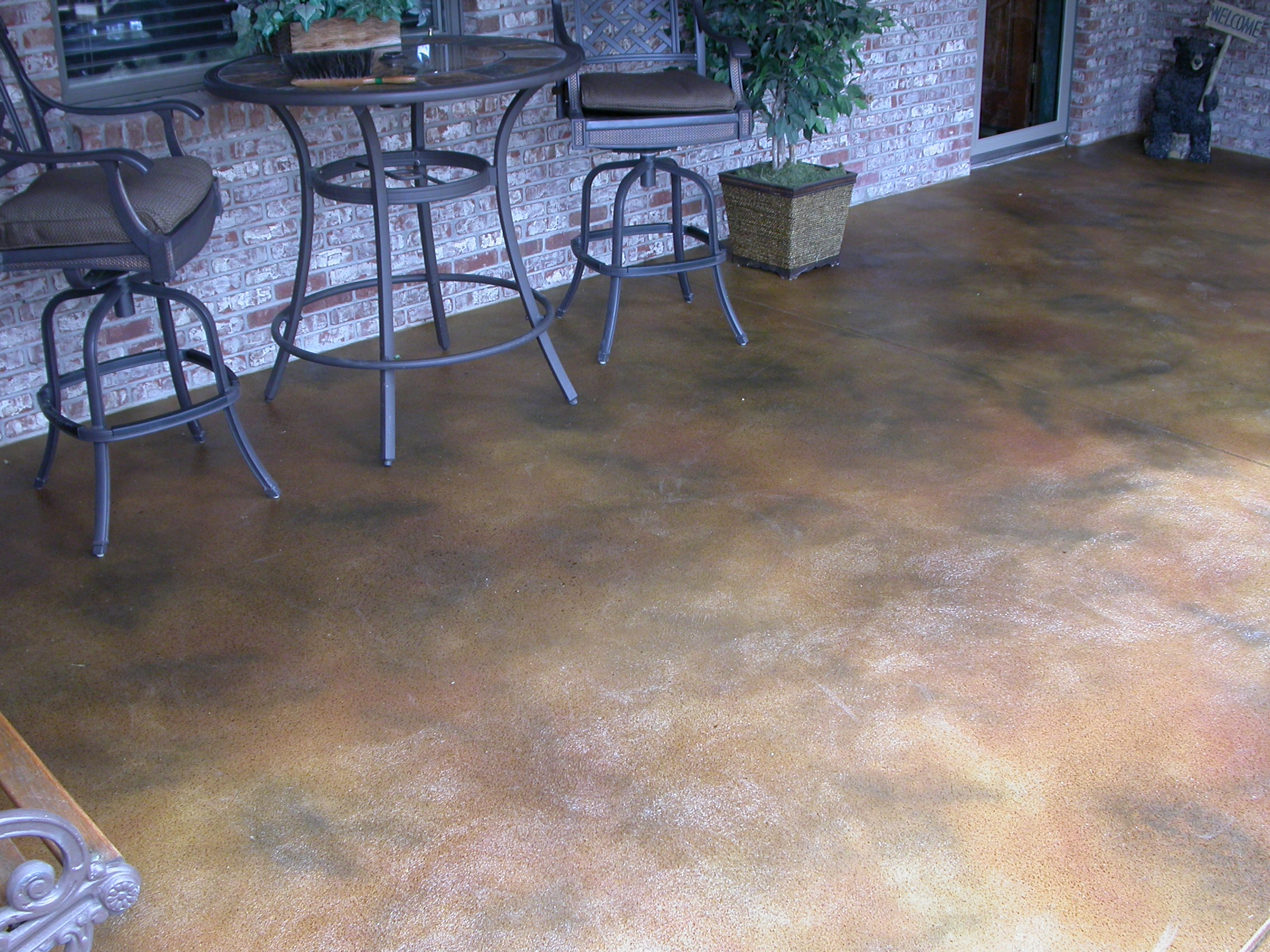 Shades of color view image of concrete floor finishes for Acid wash concrete patio